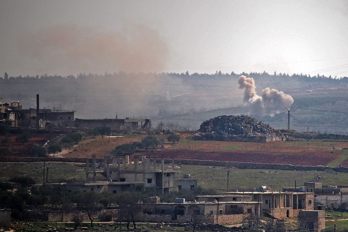 Smoke billows following reported shelling by government forces on the northwestern Syrian town of Barah, in the rebel held Idlib province on 12 February 2021. [ABDULAZIZ KETAZ/AFP via Getty Images]