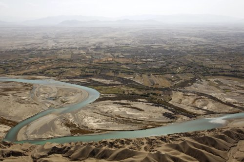 An aerial view from a medevac helicopter shows the Helmand river Helmand province on 8 November 2011. [BEHROUZ MEHRI/AFP via Getty Images]