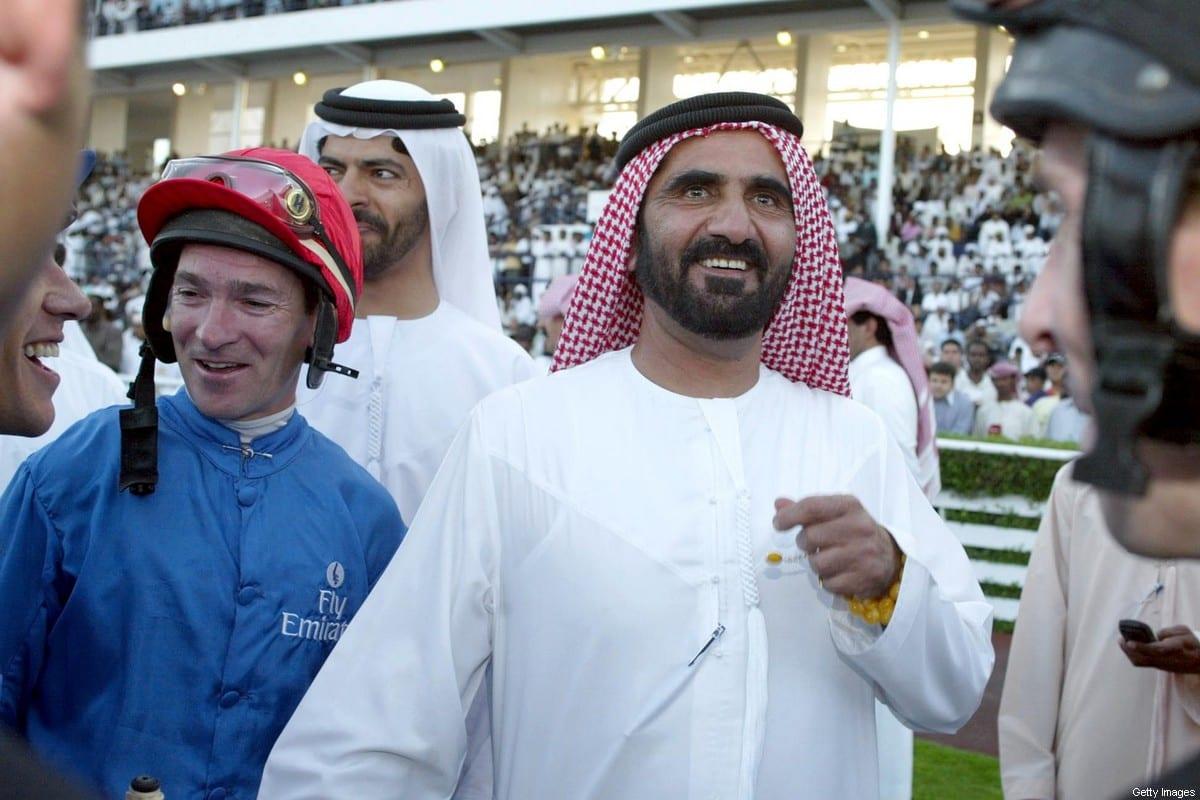 Crown Prince of Dubai Sheikh Mohammed bin Rashid al-Maktoum (R) in Dubai on 23 March 2002 [RABIH MOGHRABI/AFP via Getty Images]