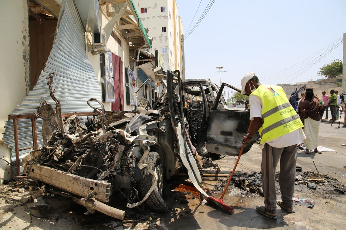 """MOGADISHU, SOMALIA - FEBRUARY 13: Wreckages of cars are seen on the scene of a huge car bomb blast that targeted a security checkpoint near the Somali parliament headquarters in the capital Mogadishu on February 13, 2021. At least seven people were wounded when a suicide car bomb blast targeted a security checkpoint near the Somali parliament headquarters in the capital Mogadishu on Saturday, police said. """"A suicide bomber driving a Toyota Noah [vehicle] drove past a security checkpoint in the Dabka area, forcing police to open fire. At least seven people were wounded, eight cars and nine rickshaws were destroyed in the morning bombing in Mogadishu,"""" Somali police said in a statement. ( Sadak Mohamed - Anadolu Agency )"""