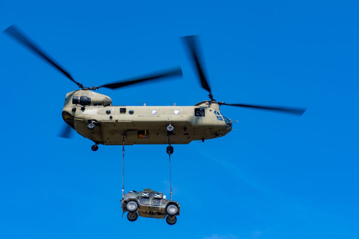 A Chinook CH-47 helicopter transports a humvee military vehicle during in the Saber Junction 20 military exercises at the Hohenfels training grounds on August 10, 2020 near Hohenfels, Germany [Lennart Preiss/Getty Images]