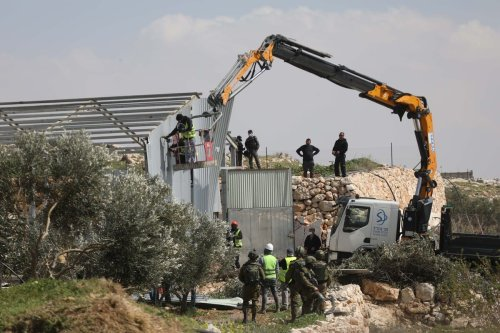 Israeli forces demolish houses belonging to three different Palestinian families in Hebron, West Bank on 2 March 2021. [Mamoun Wazwaz - Anadolu Agency]