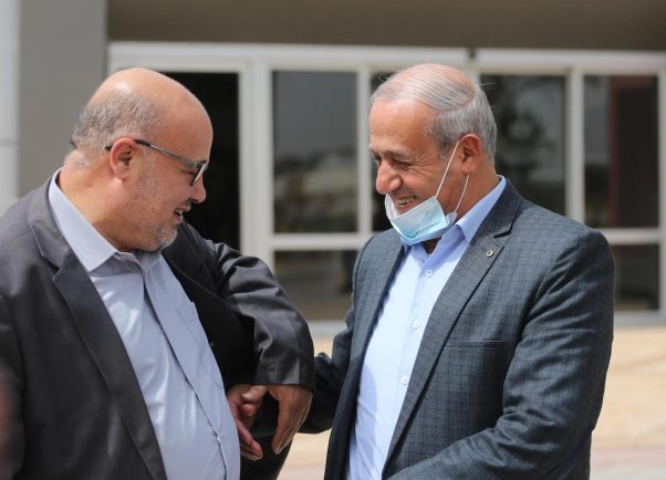 Member of Hamas Political Bureau Essam Al-Dalis (L) as Hamas delegation head to the Egyptian capital Cairo to continue talks regarding the upcoming Palestinian elections on 15 March 2021 in Gaza [Mohammed Asad/Middle East Monitor]
