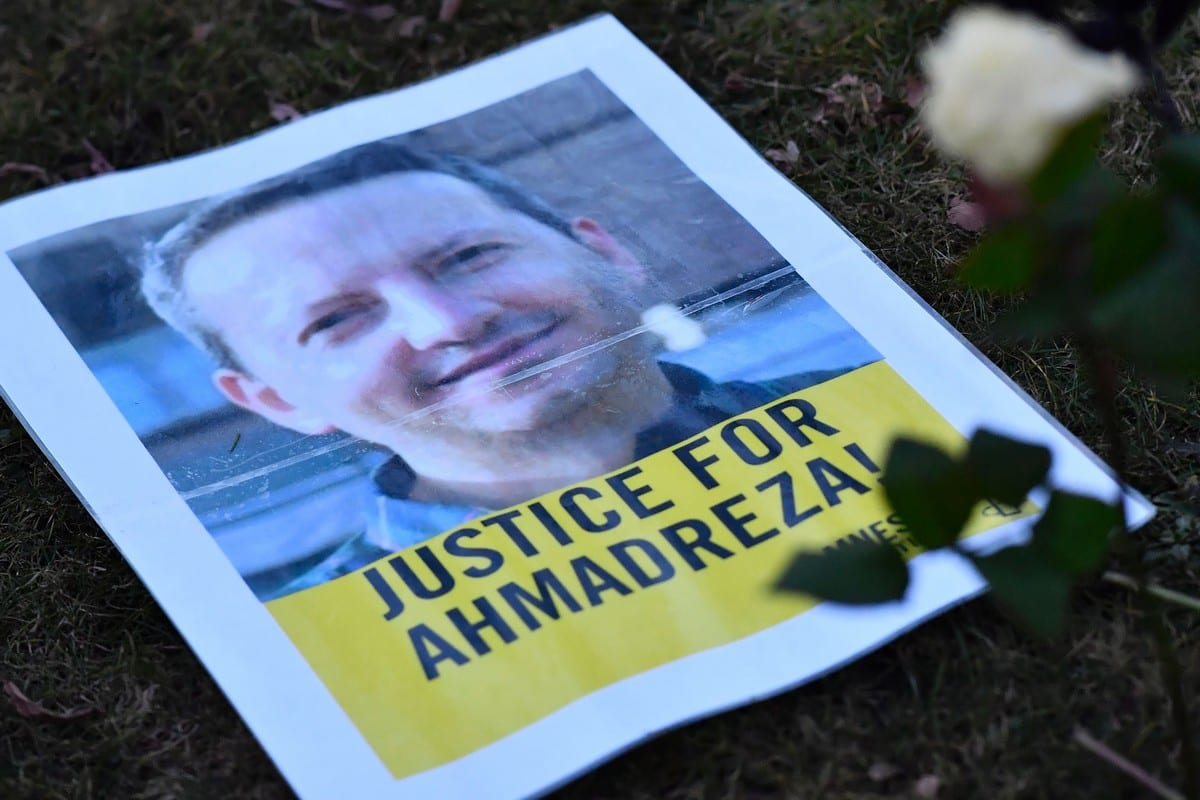 A photo taken on February 13, 2017 shows a flyer during a protest outside the Iranian embassy in Brussels for A poster from a protest in support of Ahmadreza Djalali, an Iranian academic detained in Tehran on 25 April 2016 [DIRK WAEM/AFP/Getty Images]