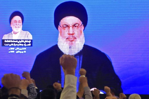 Supporters of Hassan Nasrallah, the head of Lebanon's Hezbollah movement, watch him speak through a giant screen at a mosque in the Lebanese capital Beirut's southern suburbs on 1 November 2019. [AFP via Getty Images]
