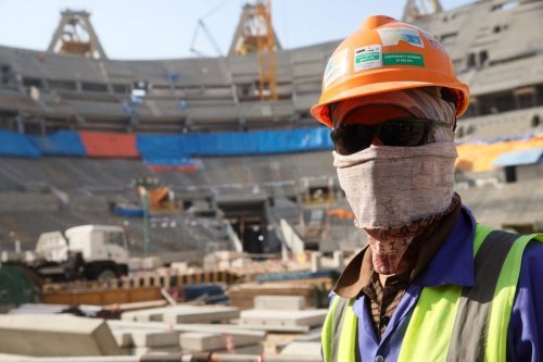Construction workers in the Lusail Iconic Stadium in Doha, Qatar on December 21, 2019 in Doha, Qatar [Matthew Ashton/AMA/Getty Images]