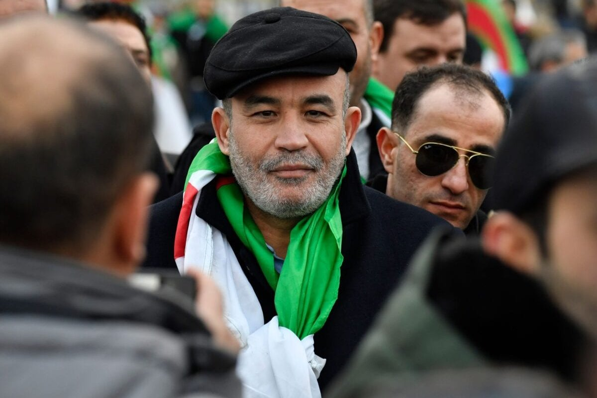 Algerian opponent of the Algerian government Mohamed Larbi Zitout attends a demonstration during the Peace summit on Libya at the Chancellery in Berlin on January 19, 2020 [JOHN MACDOUGALL/AFP via Getty Images]