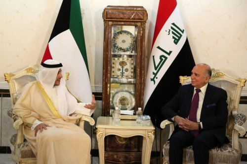 Fuad Hussein, Iraq's Forein Minister (R), meets with his Kuwaiti counterpart Sheikh Ahmad al-Nasser al-Sabah (2-L) at the ministry of foreign affairs in the capital Baghdad, on June 14, 2020 [AHMAD AL-RUBAYE/AFP via Getty Images]