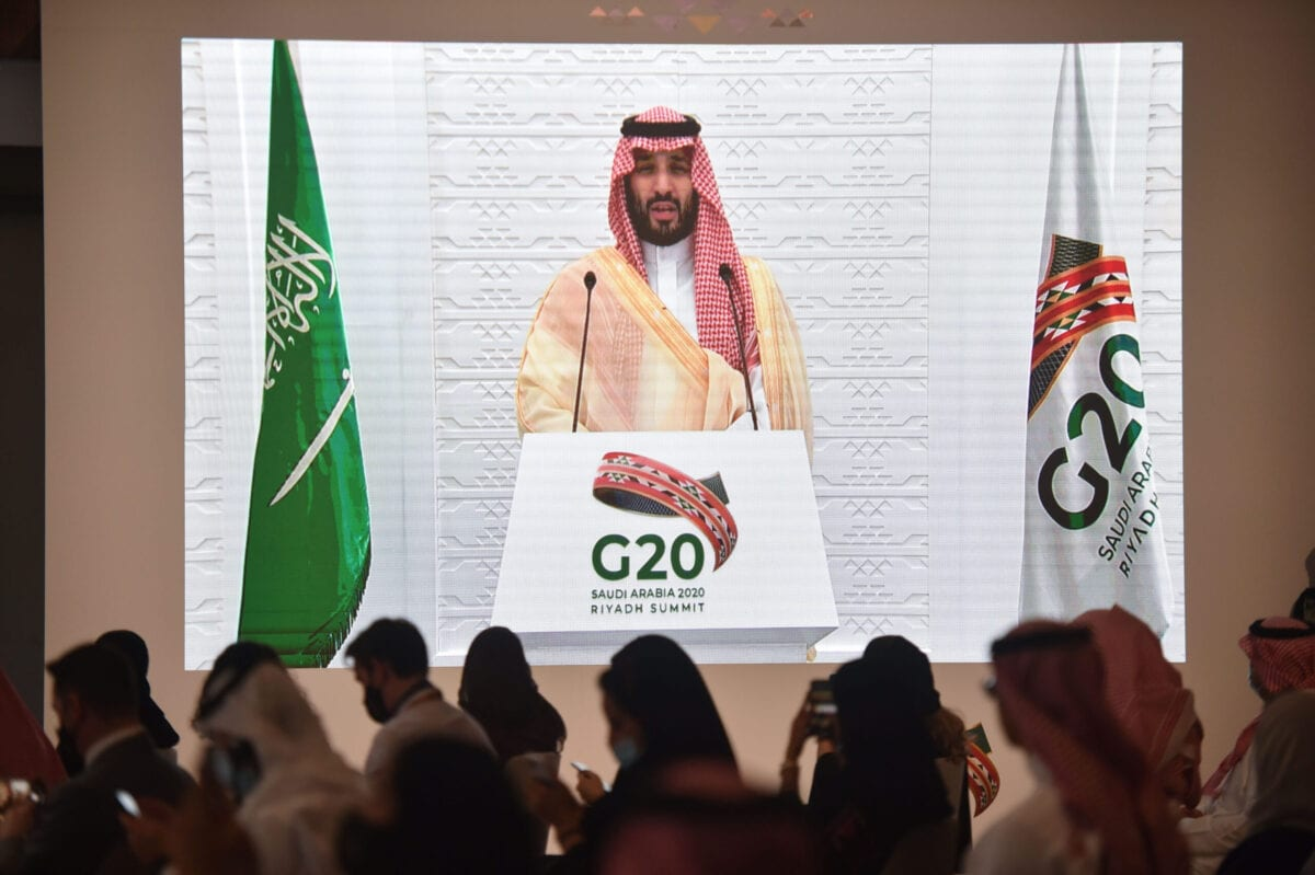 Saudi and foreign media representatives listen to Saudi Crown Prince Mohammed bin Salman remotely addressing a press conference, at the G20 summit's Media Center in the capital Riyadh, on November 22, 2020 [FAYEZ NURELDINE/AFP via Getty Images]