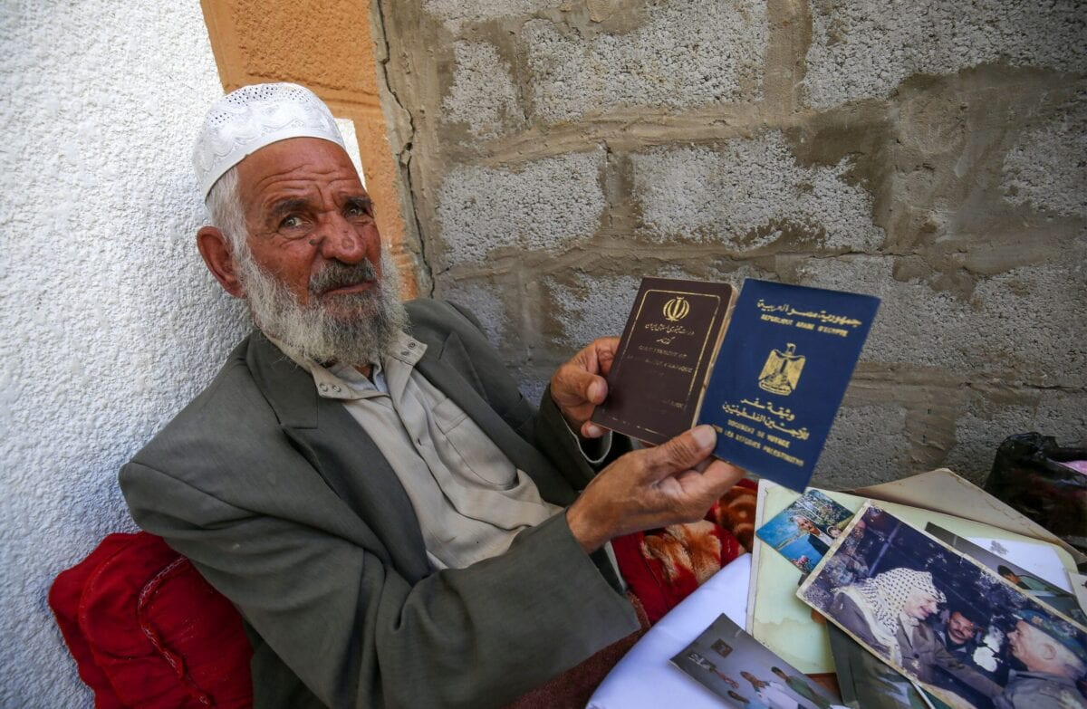 Iranian Qasem Sheyasi holds his Iranian and Egyptian travel documents in his house in Khan Yunis in the southern Gaza Strip, on November 11, 2020 [SAID KHATIB/AFP via Getty Images]
