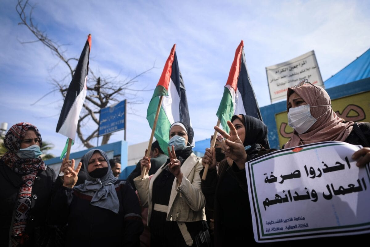 Palestinians take part in a protest against what they say are food aid cuts by the United Nations Relief and Works Agency (UNRWA) in al-Shati refugee camp in Gaza City on January 25, 2021 [MAHMUD HAMS/AFP via Getty Images]