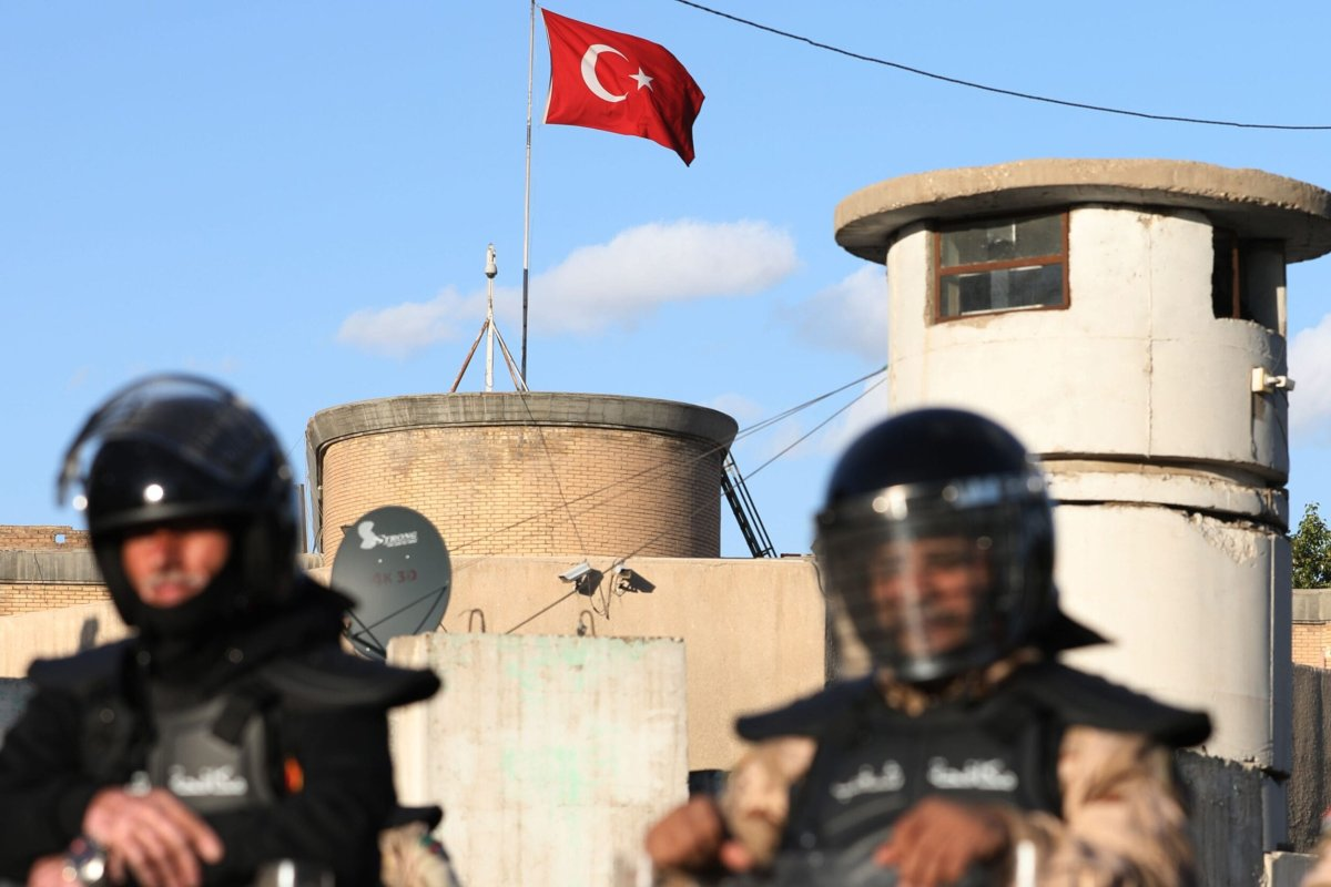 Iraqi riot police protect the Turkish embassy in Baghdad on February 18, 2021 [AHMAD AL-RUBAYE/AFP via Getty Images]