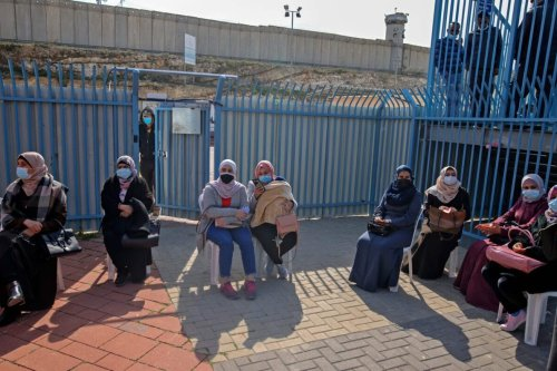 Palestinians at Qalandia checkpoint on the crossing between the West Bank city of Ramallah and Israeli-annexed east Jerusalem, on February 23, 2021 [AHMAD GHARABLI/AFP via Getty Images]