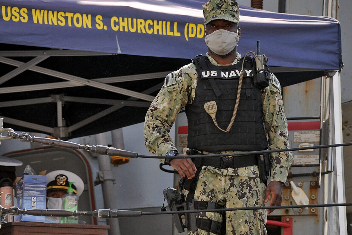A US sailor looks while standing aboard the US Navy guided-missile destroyer USS Winston S. Churchill (DDG 81), part of Destroyer Squadron 2, while it anchors in Port Sudan on March 1, 2021 [AFP via Getty Images]