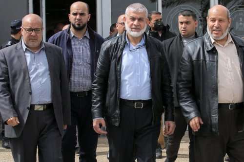 Hamas leaders Essam Aldalis (L) Rawhi Mushtaha (C) Khalil Al-Hayya (R) walk outside the VIP hall at the Rafah border crossing with Egypt in the southern Gaza Strip on March 15, 2021 [SAID KHATIB/AFP via Getty Images]