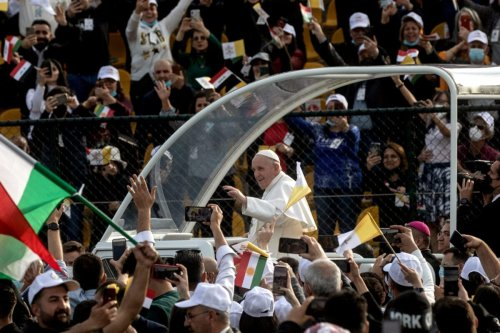 Pope Francis waves to the crowd as he arrives to conduct mass at the Franso Hariri Stadium on March 07, 2021 in Erbil, Iraq [Chris McGrath/Getty Images]