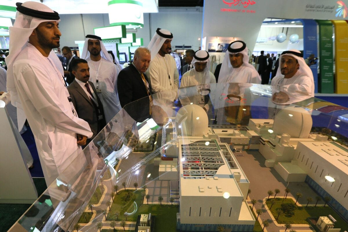 Visitors look at the Emirates Nuclear Energy Corporation presentation, during the opening the World Energy Forum 2012, at the Exhibition Centre, in Dubai, on October 22, 2012 [KARIM SAHIB/AFP via Getty Images]