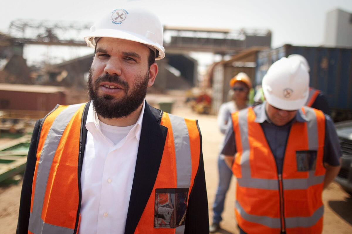Israeli billionaire Dan Gertler, left, takes a tour of the Katanga Mining Ltd. copper and cobalt mine complex with Shimon Cohen, right, his communications advisor, right, in Kolwezi, Democratic Republic of Congo, on Wednesday, Aug. 1, 2012 [Simon Dawson/Bloomberg via Getty Image]