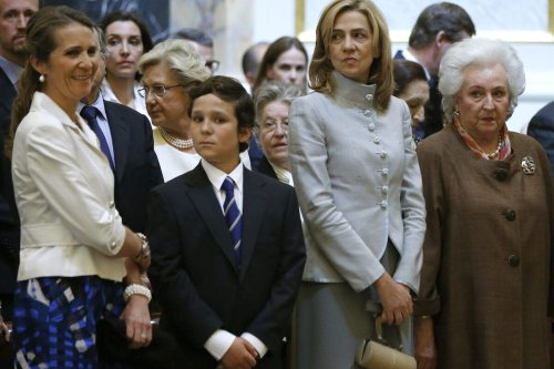 (L-R) Spanish Princess Elena and her son Juan Froilan, Spanish Princess Cristina and Spanish King's sister Pilar attend a mass commemorating the centenary of the birth of Don Juan de Borbon at the chapel of the Royal Palace in Madrid on 20 June 2013. [JUAN CARLOS HIDALGO/AFP via Getty Images]