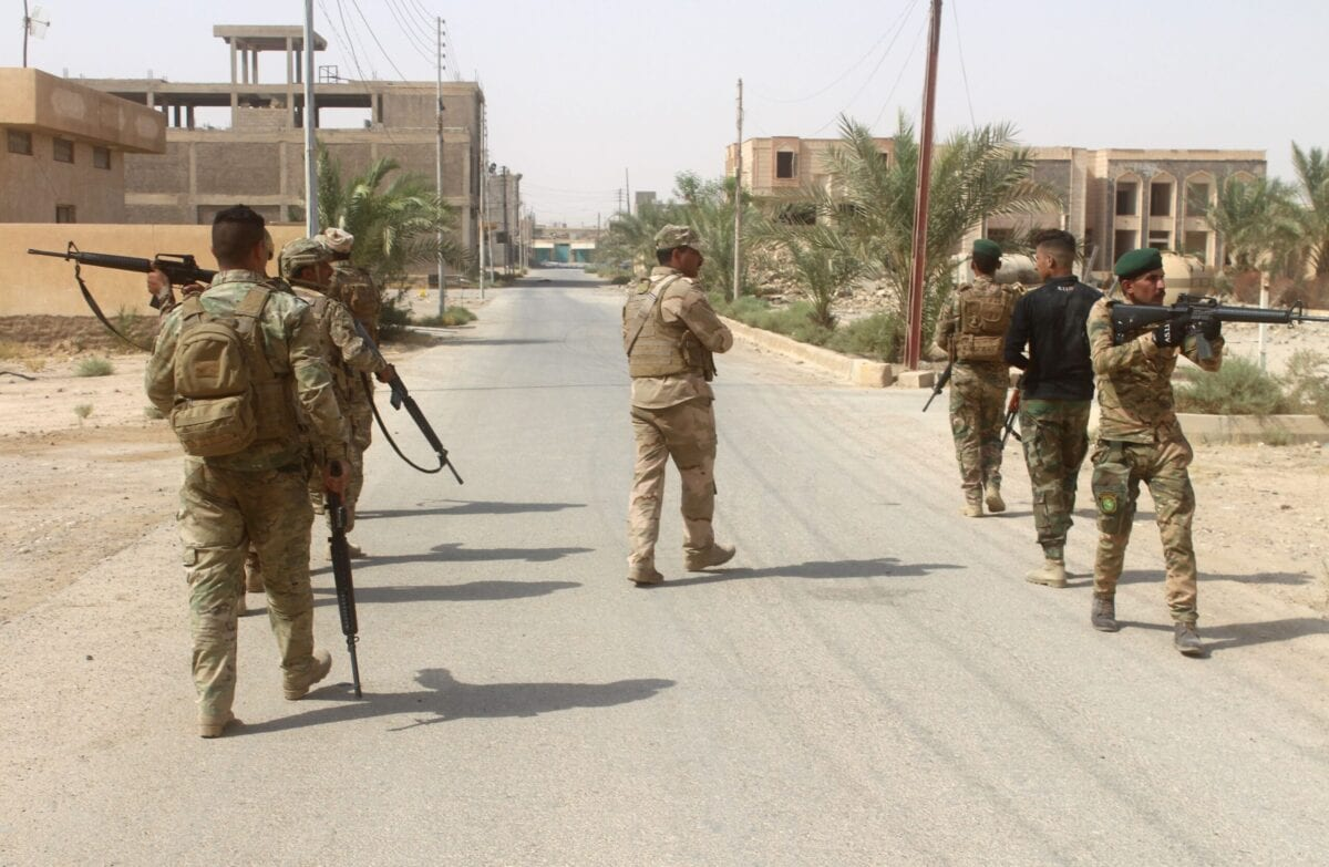 Iraqi forces members patrol during a military operation in Anbar province on September 22, 2017 [MOADH AL-DULAIMI/AFP via Getty Images]
