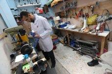 Muhammad Al-Khalidi prepares a prosthetic limb in Gaza, 18 March 2021 [Mohammed Asad/Middle East Monitor]