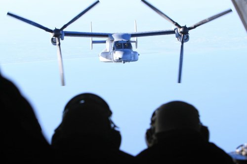 Marines observe an MV-22B Osprey aircraft en route to the USS Bataan deployed in support of Operation Odyssey Dawn in March 2011 [Gisele Tellier/Getty Images]