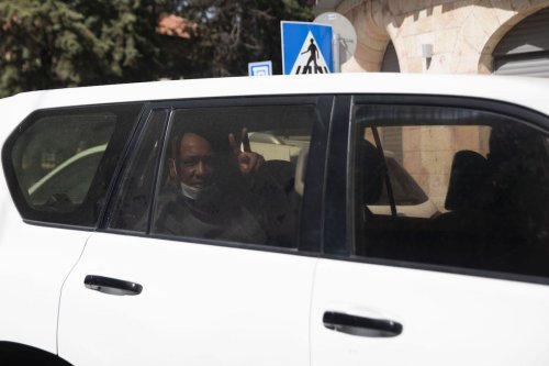 JERUSALEM - APRIL 17: A Palestinian candidate for parliamentary elections is seen in a police car after Israel forces arrested 3 Palestinian candidates and prevented a press conference on elections in Jerusalem on April 17, 2021. ( Mostafa Alkharouf - Anadolu Agency )