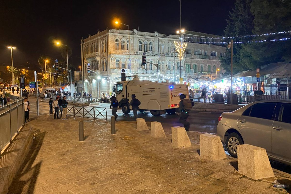 Israeli forces intervene Palestinian young Muslims, who gathered after performing Tarawih prayer, with water cannon vehicle in Eastern Jerusalem on April 18, 2021 [Mustafa Deveci/Anadolu Agency]