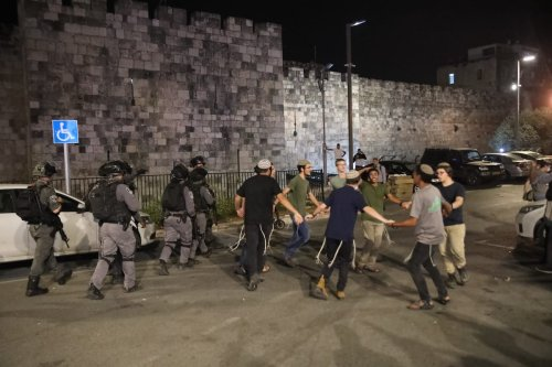 Israeli forces intervene Palestinian young Muslims, who gathered after performing Tarawih prayer, with water cannon vehicles and sound bombs and fanatic Jews arrive in Damascus Gate in Eastern Jerusalem on 18 April 2021. [Mostafa Alkharouf - Anadolu Agency]