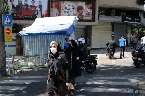 People wear face masks as a preventive measure against the coronavirus (COVID-19) in Tehran, Iran, on 17 April 2021 [Fatemeh Bahrami/Anadolu Agency]
