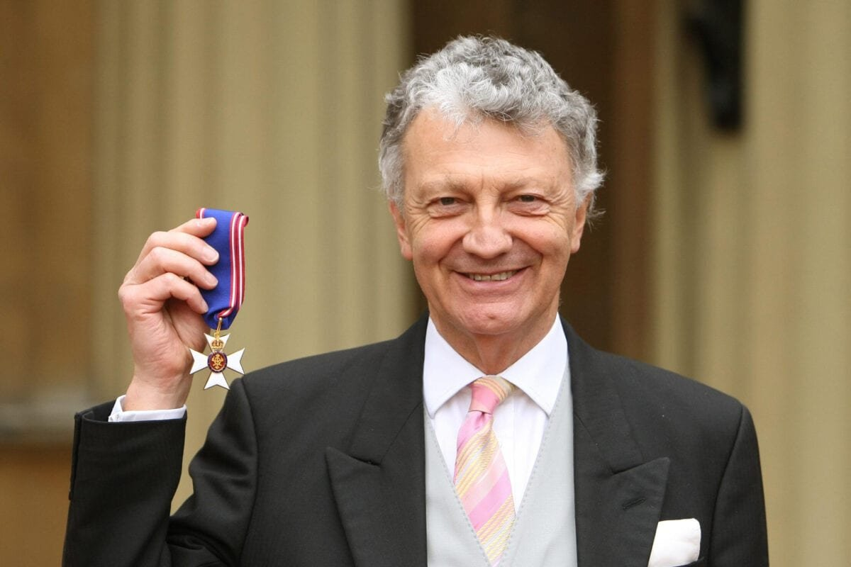 Author William Shawcross with his Commander of the Royal Victorian Order (RVO) medal, presented by Britain's Queen Elizabeth II during an investiture ceremony at Buckingham Palace on March 10, 2011 in London, United Kingdom [Dominic Lipinski/WPA Pool/Getty Images]