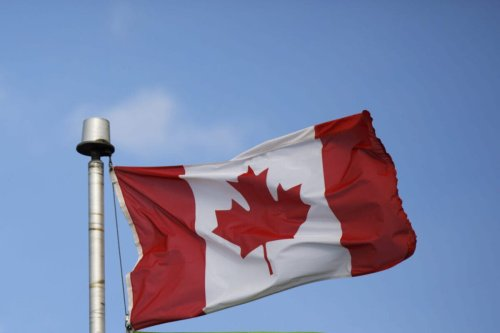 Canadian flag [Cole Burston/Bloomberg via Getty Images]