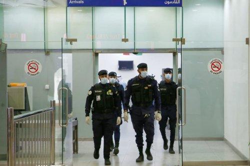Kuwaiti policemen at Sheikh Saad Airport in Kuwait City, on 22 February 2020 [YASSER AL-ZAYYAT/AFP via Getty Images]