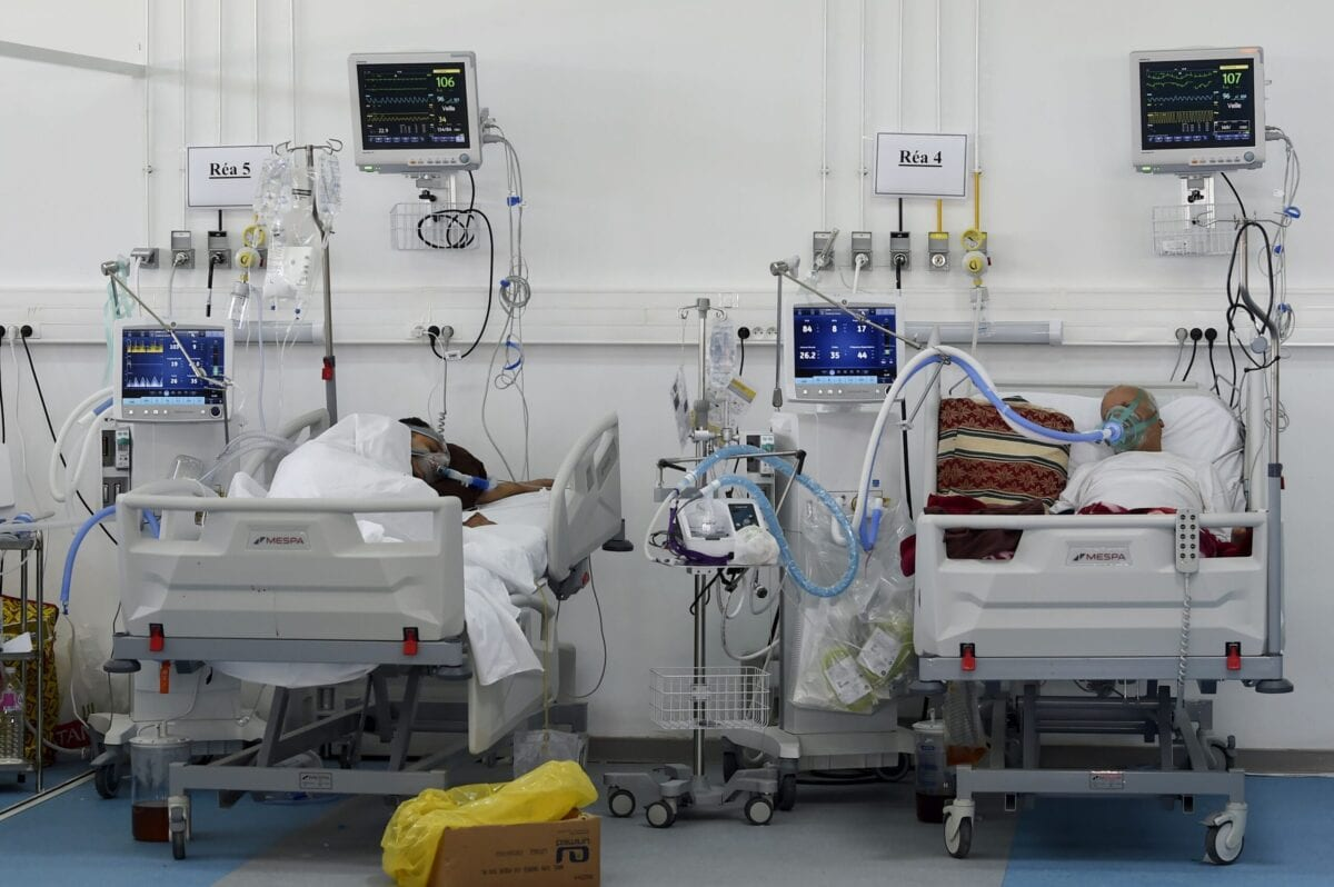 A photo taken on February 2, 2021 shows COVID-19 patients at a temporary hospital in a gym used as a resuscitation room in the Tunisian capital Tunis [FETHI BELAID/AFP via Getty Images]