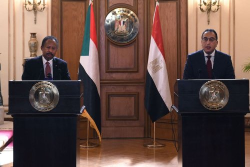 Egyptian Prime Minister Mostafa Madbouly (R) and his Sudanese counterpart Abdalla Hamdok give a joint press conference after meeting in the Egyptian capital Cairo, on 11 March 2021. [SELMAN ELOTEFY/AFP via Getty Images]