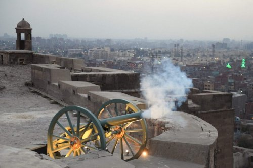 A Ramadan cannon is fired to mark the breaking of the fasting during the Muslim holy month of Ramadan at the compound of the citadel in the Egyptian capital Cairo on April 13, 2021 [AHMED HASAN/AFP via Getty Images]