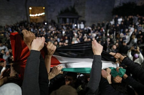 Palestinian protesters wave the national flag outside the Damascus Gate in Jerusalem's Old City on April 26, 2021 [AHMAD GHARABLI/AFP via Getty Images]