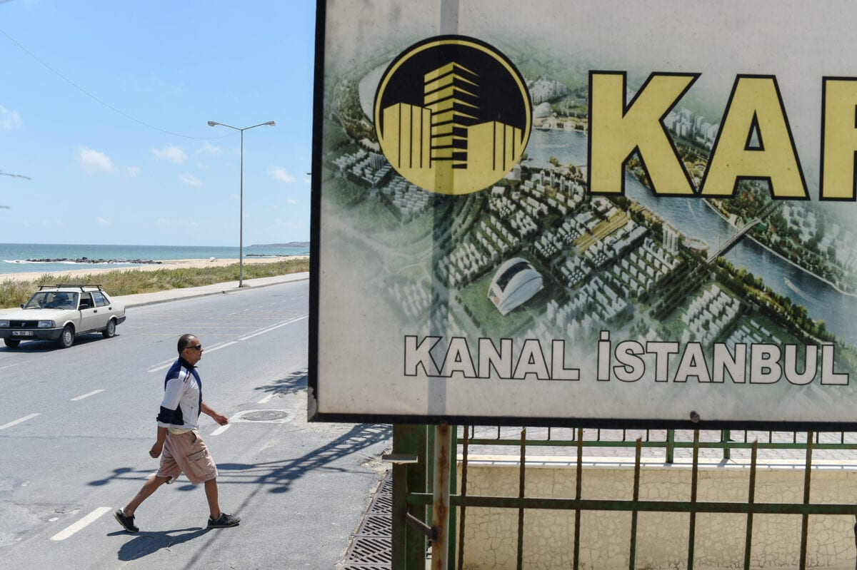 A real estate advertising offers apartments with the view on the canal, in the small coastal village of Karaburun, near Istanbul, on June 12, 2018 [YASIN AKGUL/AFP via Getty Images]