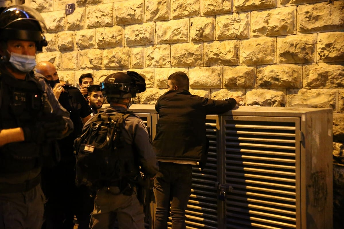Israeli forces intervene in Palestinians as they gather around the Damascus Gate after performing Tarawih prayer in Al-Aqsa Compound, in Eastern Jerusalem on April 15, 2021 [Mostafa Alkharouf/Anadolu Agency]