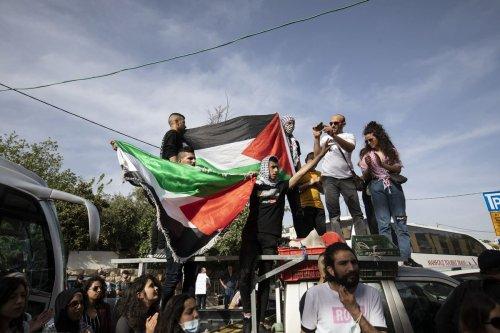 JERUSALEM - APRIL 23: Palestinian families, living in the Sheikh Jarrah neighbourhood of Eastern Jerusalem and threatened by Israel's forced migration, gather for a demonstration in Jerusalem, on April 23, 2021. ( Mostafa Alkharouf - Anadolu Agency )