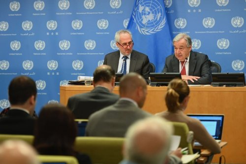 United Nations Secretary General Antonio Guterres with Stephane Dujarric (L), Spokesman for the Secretary General on 4 February 2020 in New York City [ANGELA WEISS/AFP/Getty Images]