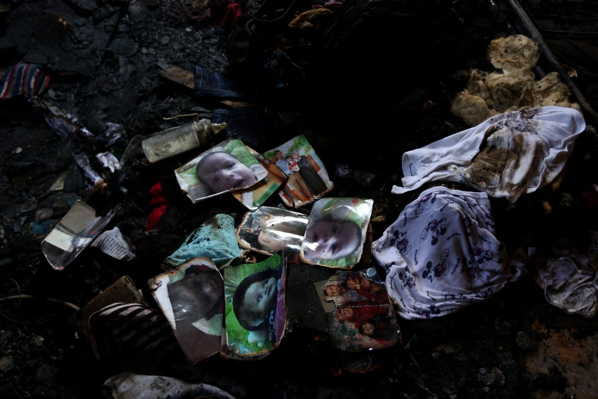 Pictures of a Palestinian boy and his family is seen burned at a house that was badly damaged in a fire in the West Bank city of Nablus, on 31 July 2015 [Ahmad Talat/ApaImages]