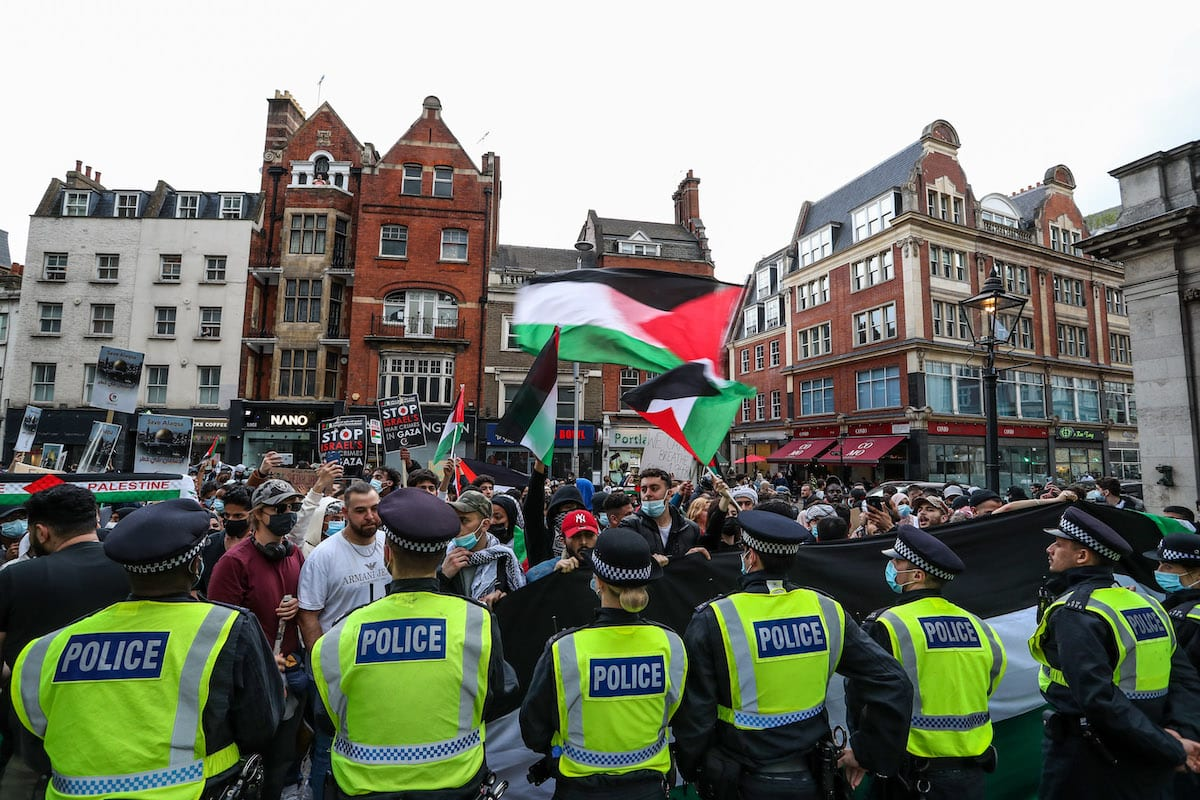 """LONDON, UNITED KINGDOM - MAY 09: Police cordon the entry of the Israeli Embassy during a """"Protest for Jerusalem"""" outside the Israeli Embassy in London, United Kingdom on May 9, 2021. This is a series of protests which will be held also in Manchester, Birmingham and Bradford against the planned evictions of Palestinian families in the Sheikh Jarrah neighbourhood of East Jerusalem this week. ( Vudi Xhymshiti - Anadolu Agency )"""