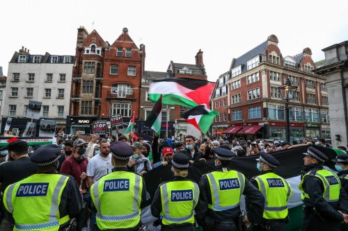 "LONDON, UNITED KINGDOM - MAY 09: Police cordon the entry of the Israeli Embassy during a ""Protest for Jerusalem"" outside the Israeli Embassy in London, United Kingdom on May 9, 2021. This is a series of protests which will be held also in Manchester, Birmingham and Bradford against the planned evictions of Palestinian families in the Sheikh Jarrah neighbourhood of East Jerusalem this week. ( Vudi Xhymshiti - Anadolu Agency )"