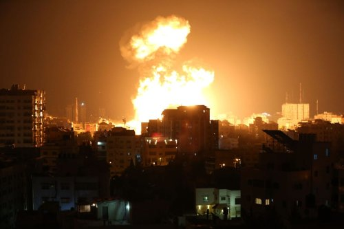 GAZA CITY, GAZA - MAY 13: Smoke and flames rise after Israeli fighter jets conducted airstrikes in Gaza City, Gaza on May 13, 2021. ( Ashraf Amra - Anadolu Agency )
