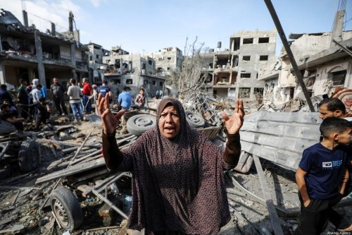 A Palestinian woman reacts as she and others search for survivors in the rubble of buildings destroyed by ongoing Israeli airstrikes on Gaza, in Beit Hanoun, Gaza on May 14, 2021 [Ali Jadallah / Anadolu Agency]