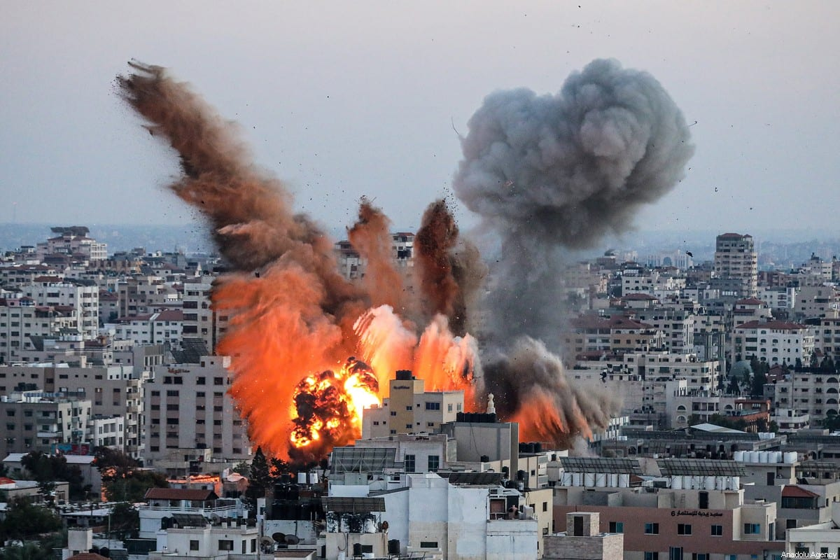 Smoke rises after airstrikes over Ansar Government Complex building in Gaza City, Gaza on May 14, 2021 [Ali Jadallah/Anadolu Agency]