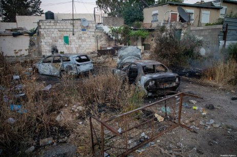 Palestinian vehicles burnt by Jewish settlers are seen in the Sheikh Jarrah neighbourhood of East Jerusalem on May 14, 2021. There has been clashes between Jewish settlers and Palestinians who were trying to forcibly evict Palestinian families from their homes in the Sheikh Jarrah neighbourhood of East Jerusalem [Eyad Tawil / Anadolu Agency]
