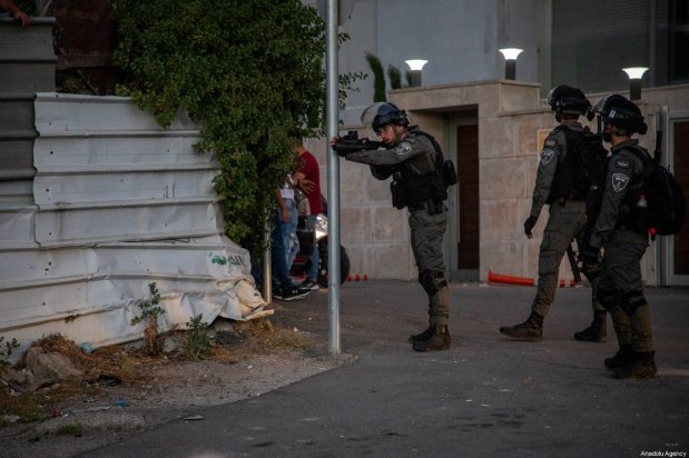 Israeli forces fire on Palestinians in the Sheikh Jarrah neighbourhood of East Jerusalem on May 14, 2021. There has been clashes between Jewish settlers and Palestinians who were trying to forcibly evict Palestinian families from their homes in the Sheikh Jarrah neighbourhood of East Jerusalem [Eyad Tawil / Anadolu Agency]