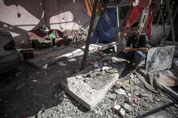 A member of Abu Dayir family inspects the damage at the yard of their house after Israeli attack on May 17, in Gaza City, Gaza on May 29, 2021 [Ali Jadallah/Anadolu Agency]